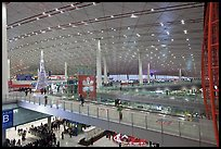 Inside main concourse at dusk, Beijing Capital International Airport. Beijing, China (color)