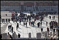 Crowd of tourists in the Sea of Flagstone (court of the imperial palace), Forbidden City. Beijing, China (color)