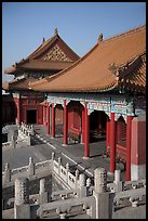 Pavilion with red columns and yellow roof tiles typical of imperial architecture, Forbidden City. Beijing, China