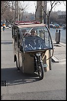 Enclosed three wheel motorcycle on street. Beijing, China ( color)