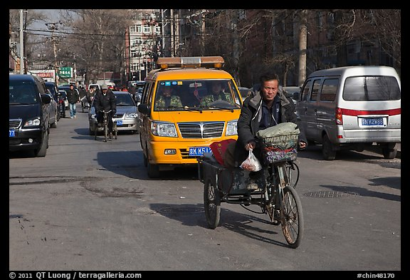 Tricycle and taxi on street. Beijing, China (color)