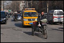 Tricycle and taxi on street. Beijing, China ( color)