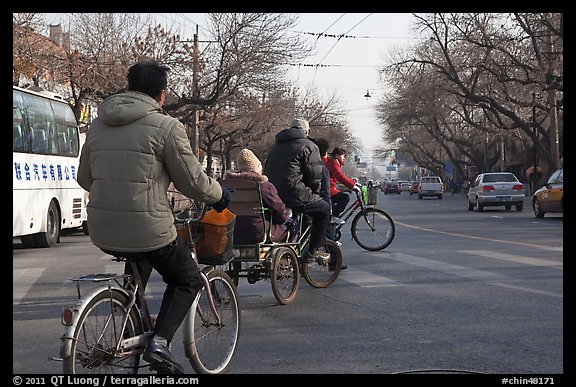 Bicyles and cyclo on street. Beijing, China (color)