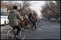 Bicyles and cyclo on street. Beijing, China ( color)
