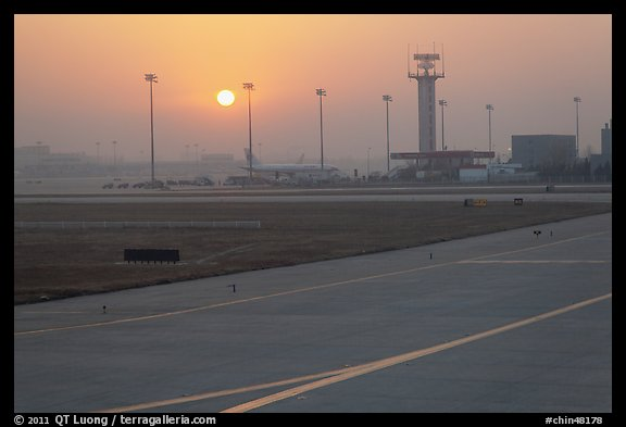 Tarmac and control tower at sunset, Beijing Capital International Airport. Beijing, China (color)