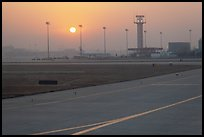 Tarmac and control tower at sunset, Beijing Capital International Airport. Beijing, China ( color)