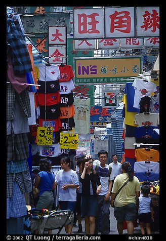 Crowded alley with clothing vendors, Kowloon. Hong-Kong, China