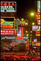 Nathan road, brilliantly lit by neon lights at night, Kowloon. Hong-Kong, China (color)
