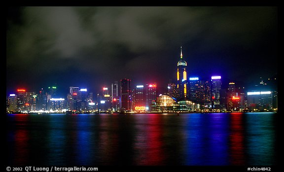 Colorful reflexions of Hong-Kong Island lights across the harbor by night. Hong-Kong, China