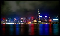 Colorful reflections of Hong-Kong Island lights across the harbor by night. Hong-Kong, China