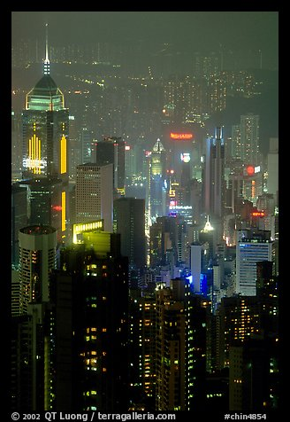 Center building with changing lights from Victoria Peak at night. Hong-Kong, China (color)