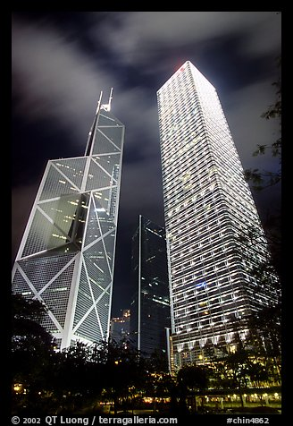 Bank of China (369m) and Cheung Kong Center (290m) buildings at night. Hong-Kong, China (color)