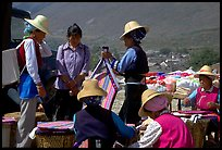 Bai women wearing tribespeople dress at the Monday market. Shaping, Yunnan, China