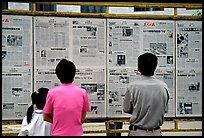 Reading dazibao (public newspapers). Kunming, Yunnan, China ( color)