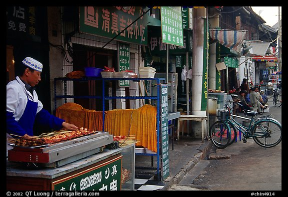 Muslim cook at restaurant storefront. Kunming, Yunnan, China (color)