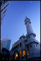 Nancheng Mosque built recently, a hybrid of white-tiled high rise with a mosque's green onion domes. Kunming, Yunnan, China (color)