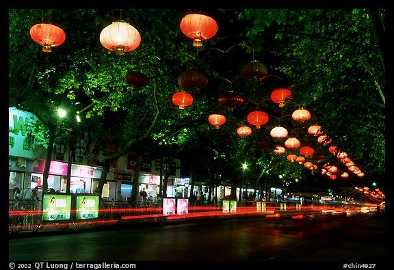 Zhengyi Lu illuminated by lanterns at night. Kunming, Yunnan, China