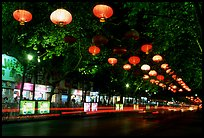 Zhengyi Lu illuminated by lanterns at night. Kunming, Yunnan, China (color)