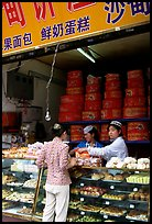 Women at Muslim pastry store. Kunming, Yunnan, China