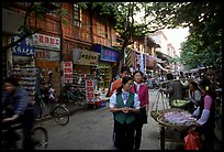 Street vendors in an old street. Kunming, Yunnan, China