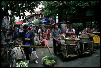 Street food vendors in an old alley. Kunming, Yunnan, China (color)