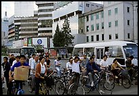 Bicyclists waiting for traffic light. Kunming, Yunnan, China