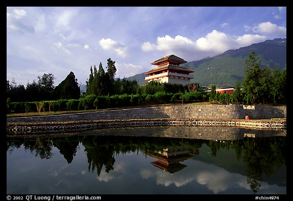 Chong-sheng Si, temple behind the Three Pagodas, reflected in a pond. Dali, Yunnan, China (color)
