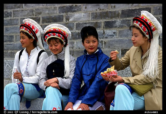 Women wearing traditional Bai dress. Dali, Yunnan, China