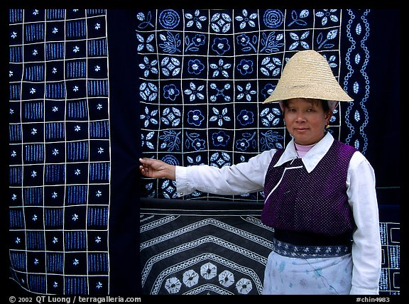 Woman in Bai dress showing drapes of traditional design. Dali, Yunnan, China (color)