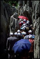 Crowds of Chinese tourists in a walkway among the limestone pillars. Shilin, Yunnan, China ( color)