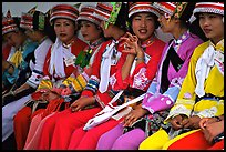 Tour guides dressed with traditional Sani outfits. Shilin, Yunnan, China