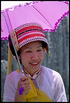 Woman from the Sani branch of the Yi tribespeople with a sun unbrella. Shilin, Yunnan, China