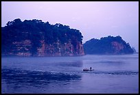 Cliffs of Lingyun Hill and Wuyou Hill at dusk, whose shape evokes a lying buddha. Leshan, Sichuan, China