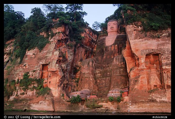 Da Fo (Grand Buddha) and two guardians seen from the river. Leshan, Sichuan, China (color)