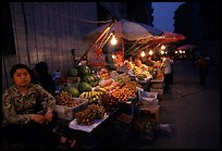 Fruit vendor, night market. Leshan, Sichuan, China ( color)