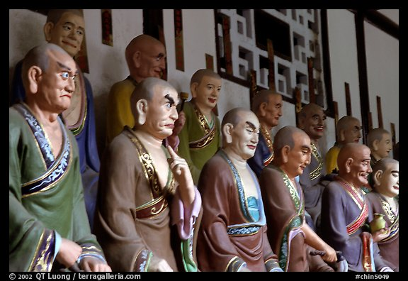 A variety of postures and expressions of some of the 1000 Terracotta arhat monks in Luohan Hall. Leshan, Sichuan, China (color)