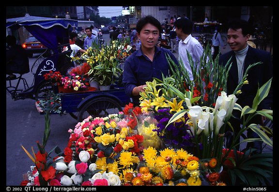 Flower vendor, night market. Leshan, Sichuan, China
