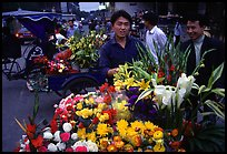 Flower vendor, night market. Leshan, Sichuan, China (color)