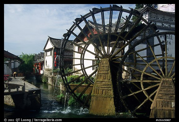 Big water wheel at the entrance of the Old Town. Lijiang, Yunnan, China