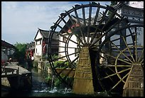 Big water wheel at the entrance of the Old Town. Lijiang, Yunnan, China (color)