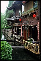 Restaurant across the canal. Lijiang, Yunnan, China (color)