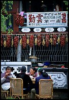 Women eat outside the Snack Food in Lijiang restaurant. Lijiang, Yunnan, China