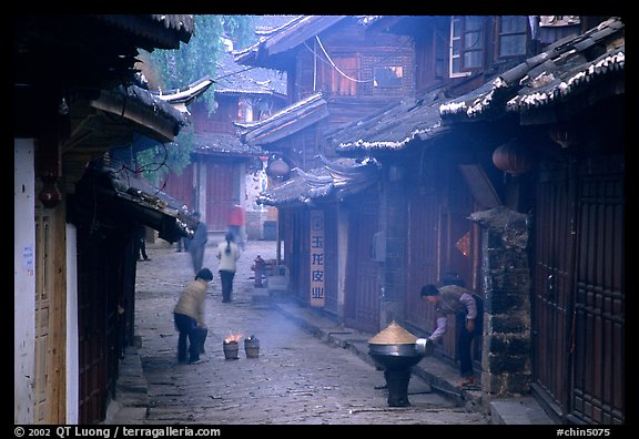 Street in the morning with dumplings being cooked. Lijiang, Yunnan, China (color)