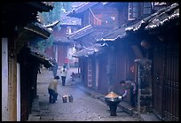 Street in the morning with dumplings being cooked. Lijiang, Yunnan, China
