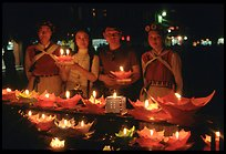 Candlelight lanters to be floated on a canal at night. Lijiang, Yunnan, China