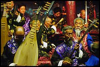 Elderly musicians of the Naxi Orchestra playing traditional instruments. Lijiang, Yunnan, China ( color)