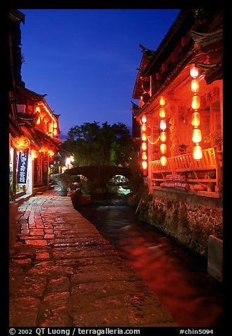 Cobblestone street and canal at night. Lijiang, Yunnan, China (color)