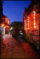 Cobblestone street and canal at night. Lijiang, Yunnan, China