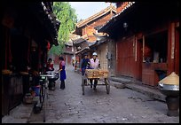 Early morning activity in a cobblestone street. Lijiang, Yunnan, China