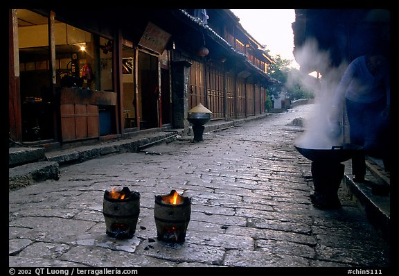 Dumplings being cooked in a cobblestone street. Lijiang, Yunnan, China (color)